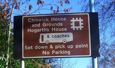 Review of White on Brown Tourism Road Signs in London Picture